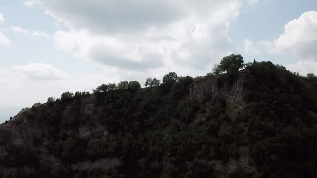 aerial forward ascend: trees on mountain against sky - rupit, spain - tall high stock videos & royalty-free footage