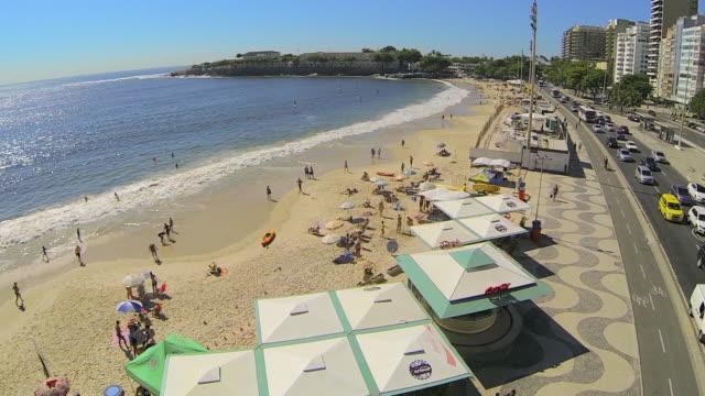 aerial forward: beach beside the road in brazil - sunny video stock e b–roll
