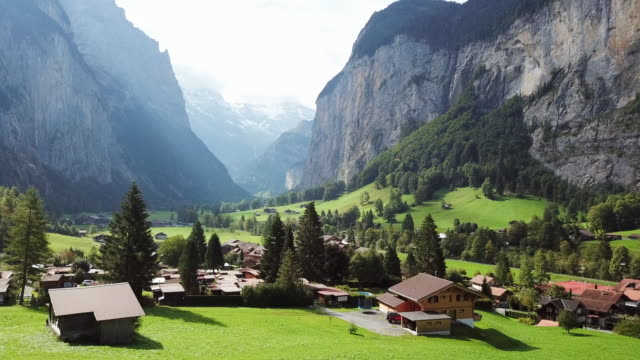 aerial forward: beautiful homes at the valley of kleine scheidegg - switzerland stock videos & royalty-free footage