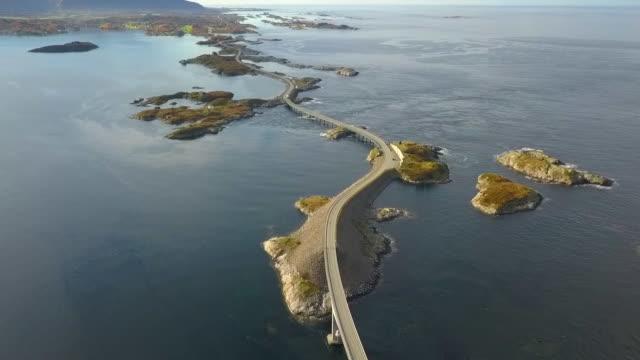 aerial forward: breathtaking road in the ocean, atlantic road, norway - atlantic ocean stock videos & royalty-free footage