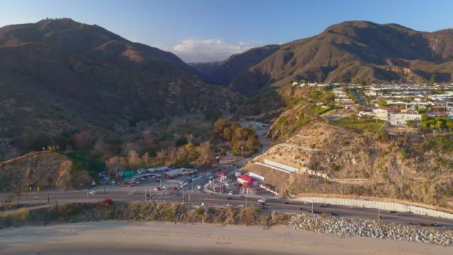 aerial forward: busy streets of malibu california - malibu stock videos & royalty-free footage
