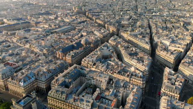 aerial forward: city buildings in maze form on sunny day in paris, france - paris bildbanksvideor och videomaterial från bakom kulisserna