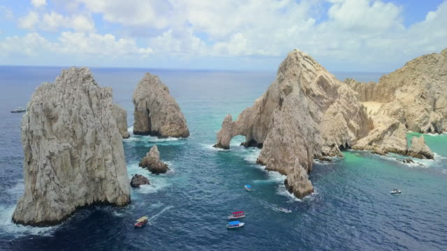 aerial forward descending slow towards the arch in cabo san lucas - arch stock videos & royalty-free footage