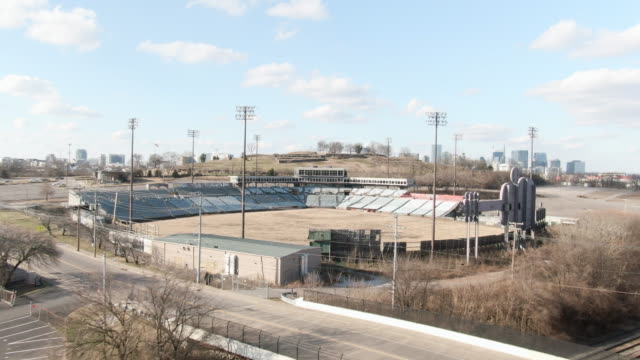 aerial forward: dilapidated seating and press boxes of abandoned minor league baseball stadium on outskirts of nashville - dugout stock videos & royalty-free footage
