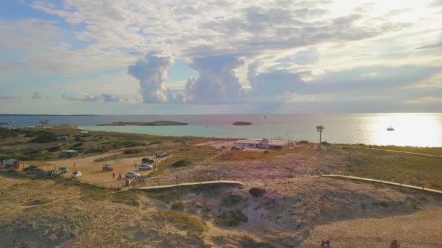 vídeos y material grabado en eventos de stock de aerial forward: enjoying the ibiza beach - horizonte