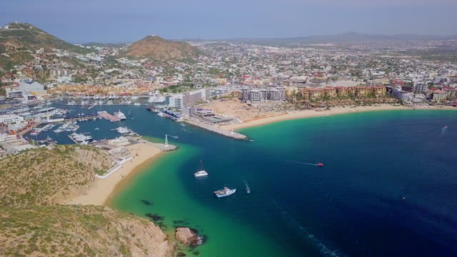 aerial forward: entrance to the docks of city - cabo san lucas stock videos & royalty-free footage
