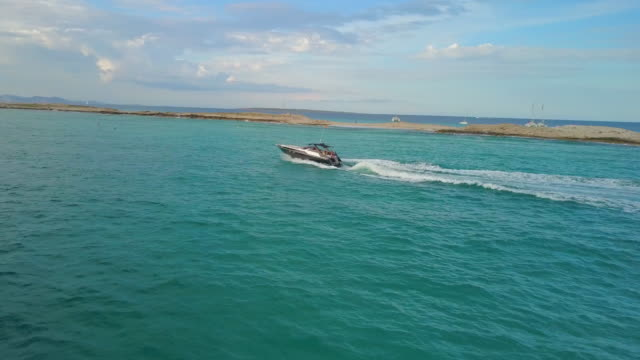 aerial forward: fast speed boat on the water - balearic islands stock videos and b-roll footage