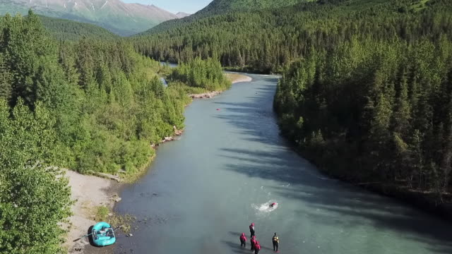 aerial forward: going with flow of river - chugach national forest stock videos & royalty-free footage