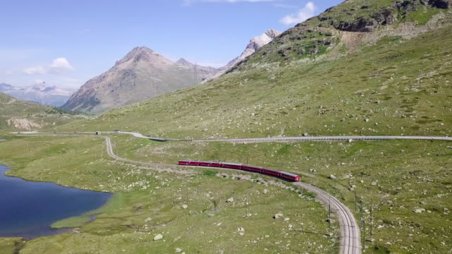aerial forward: moving forward riding a train in bernina pass switzerland - plain stock videos & royalty-free footage
