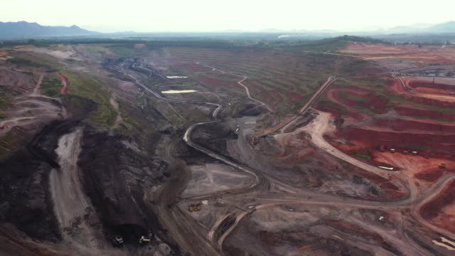 aerial forward of lignite coal mine - coal mine stock videos & royalty-free footage