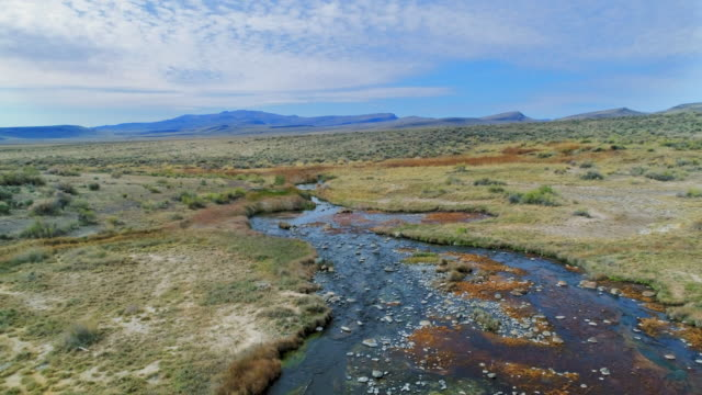 aerial forward: peaceful soldier meadows hot spring - meadow stock videos & royalty-free footage