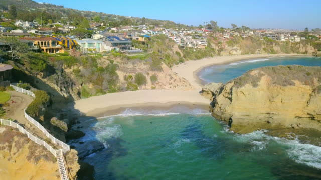 aerial forward: people at laguna beach california - laguna beach california stock videos & royalty-free footage