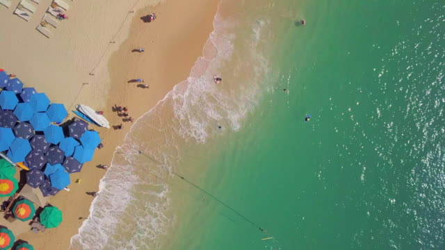 aerial forward: people at the beach of mexico - cabo san lucas stock videos and b-roll footage