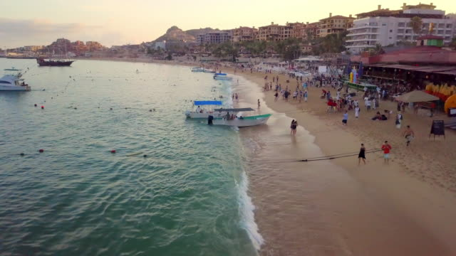 aerial forward rise: activities in beach of mexico - cabo san lucas stock videos & royalty-free footage