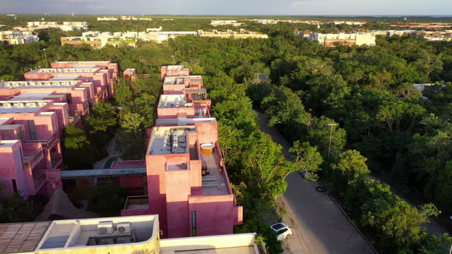 aerial forward shot of hotels with swimming pool on rooftop by footpath on sunny day - tulum, mexico - famous place stock videos & royalty-free footage