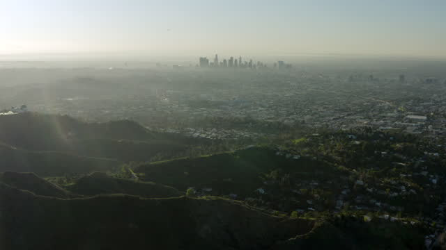 aerial forward slow: big city covered with fog - los angeles, california - aerial stock videos & royalty-free footage