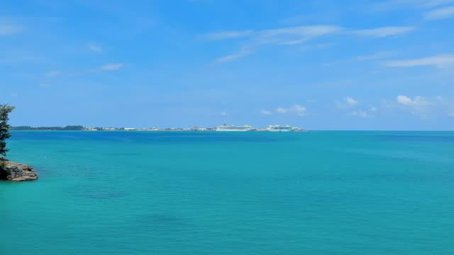 aerial forward slow: big cruise ships docked in the blue waters of bermuda in spanish point, bermuda - bermuda stock videos & royalty-free footage