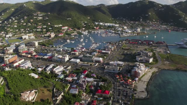 aerial forward slow: city of san juan puerto rico surrounded by mountains - puerto rico stock videos & royalty-free footage