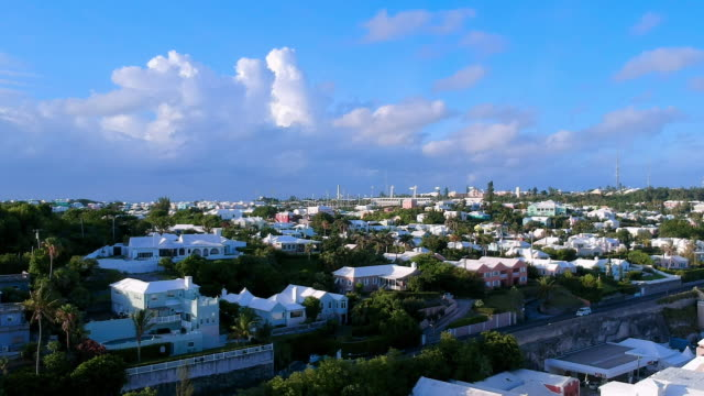 aerial forward slow: lovely city of bermuda full of different structures in spanish point, bermuda - bermuda stock videos & royalty-free footage