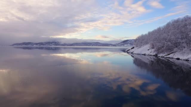 aerial forward slow: white lake of lofoten norway - lofoten, norway - nordland county stock videos & royalty-free footage