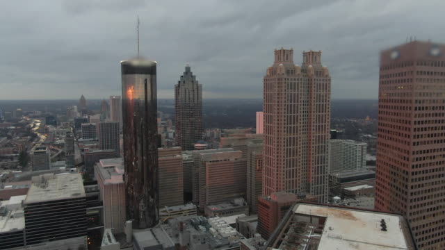 Aerial Forward: Striking Skyscrapers and Urban Architecture in Downtown Atlanta at Sunset