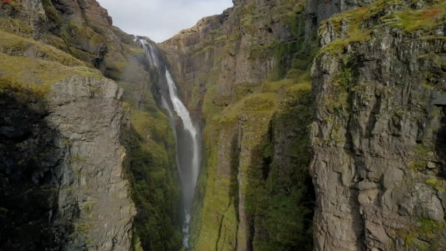 aerial forward: stunning glymur waterfall in amazing canyon, hvalfjordur, iceland - canyon video stock e b–roll
