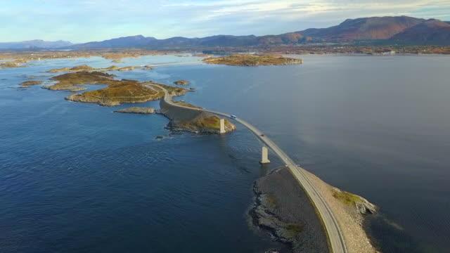 aerial forward: stunning road in the ocean, atlantic road, norway - 沿岸点の映像素材/bロール