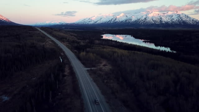 aerial forward: swift river reflecting the mountain - snowcapped mountain stock videos & royalty-free footage