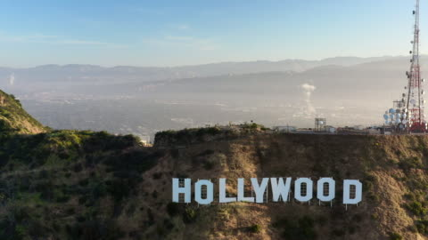 aerial forward: the hollywood sign and north los angeles at sunset - hollywood, california - actor stock videos & royalty-free footage