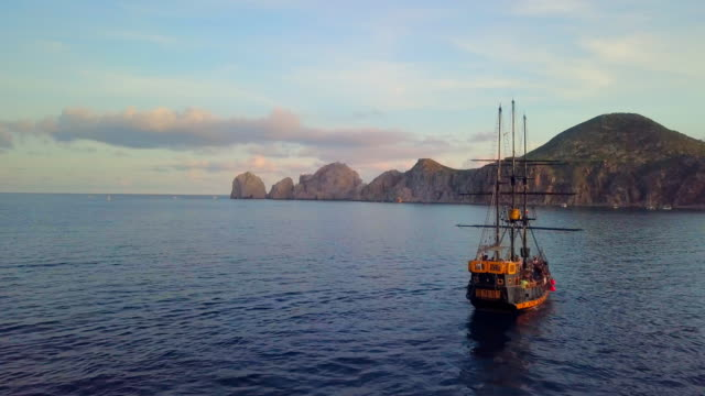 aerial forward: travelling to the rock cliffs in mexico - cabo san lucas stock videos & royalty-free footage
