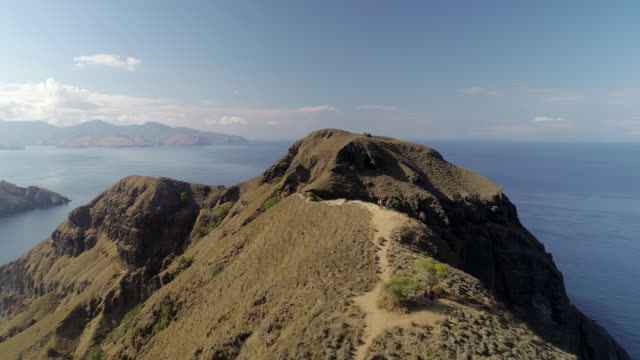 aerial forward: view from the top of komodo island of indonesia - insel komodo stock-videos und b-roll-filmmaterial