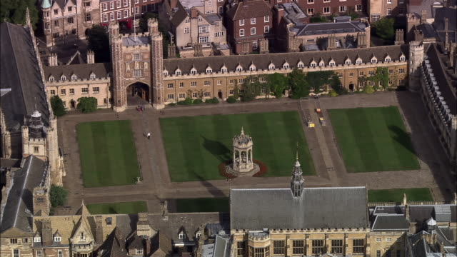 aerial fountain in great court of trinity college, cambridge university / cambridge, england - trinity college cambridge university stock videos & royalty-free footage