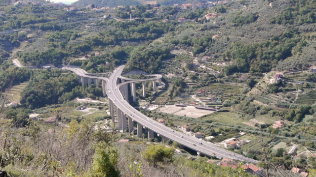 w/s aerial freeway in finale ligure, italy - spoonfilm stock-videos und b-roll-filmmaterial
