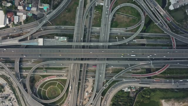 aerial freeway interchange - motorway stock videos & royalty-free footage