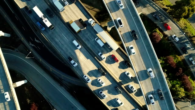 aerial freeway slow motion - ingorgo stradale video stock e b–roll