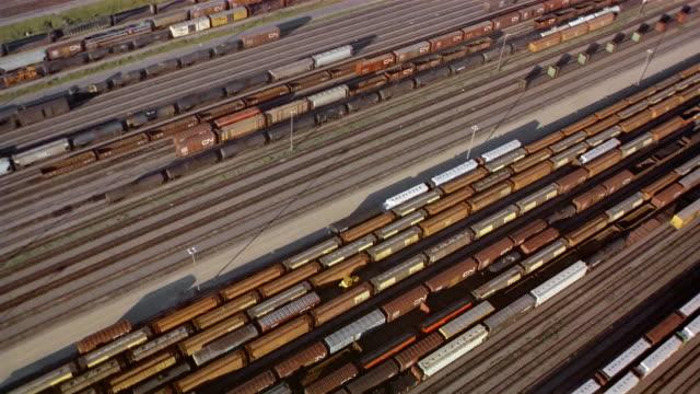 aerial freight trains in railway yard / british columbia, canada - 操車場点の映像素材/bロール