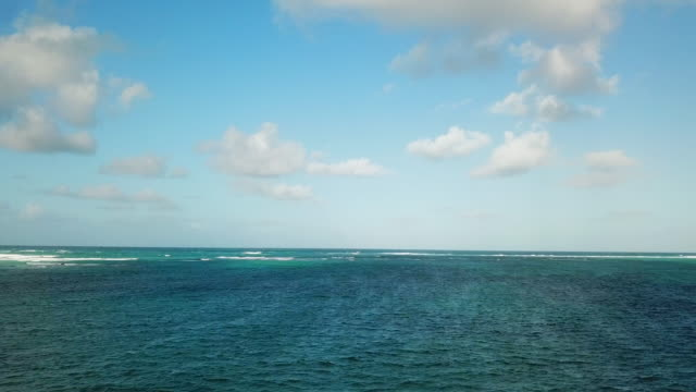 aerial: from blue sky to blue ocean in punta cana - punta cana stock videos and b-roll footage