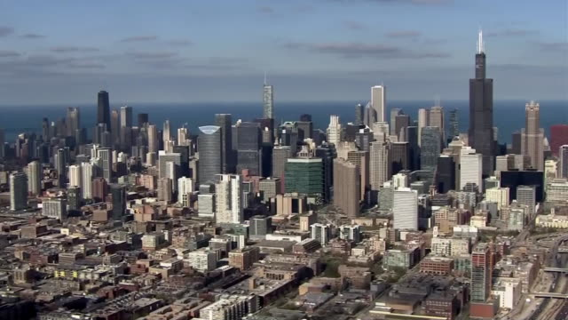 aerial from helicopter of the chicago skyline during the day - willis tower stock videos & royalty-free footage