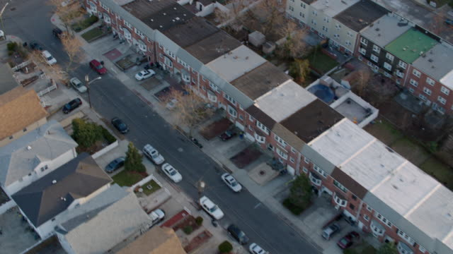 Aerial from helicopter over New Jersey residential area in the late afternoon
