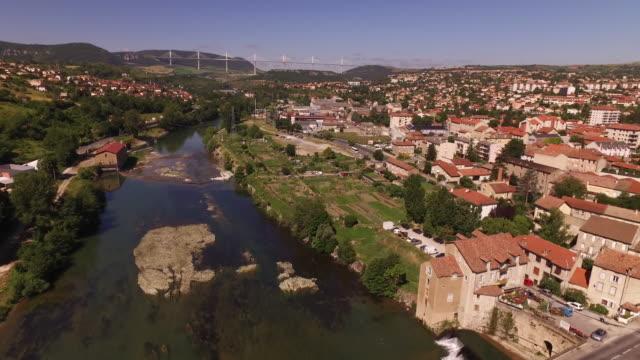 aerial from millau viaduct to millau old bridge along river tarn - viaduct stock videos & royalty-free footage