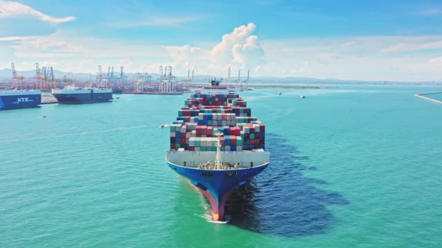 aerial front view container cargo ship full load container moving on the sea for business logistic, import export, shipping or transportation. - tanker stock videos & royalty-free footage