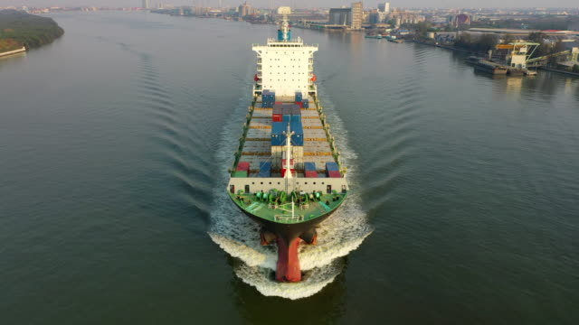 aerial front view container cargo ship moving to the sea for business logistic, import export shipping or transportation. - front view stock videos & royalty-free footage
