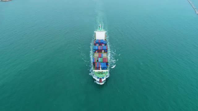 aerial front view container ship moving on the sea for logistics , shipping , import export or transportation. - cargo ship stock videos & royalty-free footage