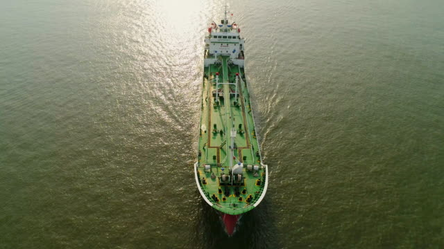 aerial front view oil ship tanker going to refinery for load/unload oil for transportation. - landfahrzeug stock-videos und b-roll-filmmaterial