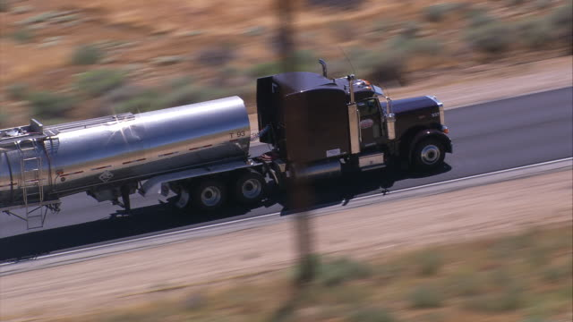 Aerial TS CU LA fuel tanker on road / Mojave Desert, California, United States.