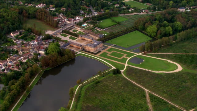 aerial ws gardens and grounds surrounding chateau de dampierre castle in dampierre-en-yvelines / yvelines, ile-de-france, france - 17th century style stock videos & royalty-free footage