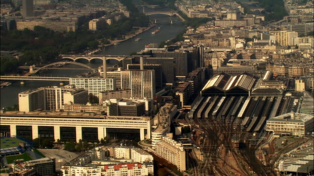 aerial ws gare de lyon railway station and cityscape along seine river / paris, france - station stock videos and b-roll footage