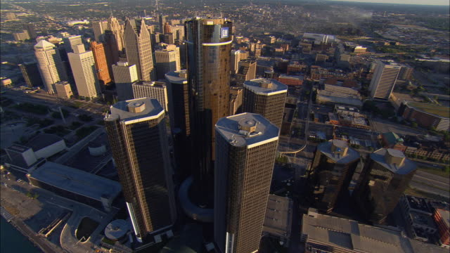 aerial ws general motors headquarters at renaissance center with surrounding downtown buildings along detroit river / detroit, michigan, usa - general motors stock videos & royalty-free footage