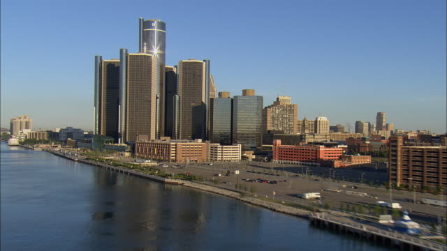 aerial ws general motors headquarters at renaissance center with surrounding downtown buildings along detroit river / detroit, michigan, usa - michigan stock videos & royalty-free footage