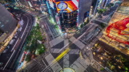 4K Aerial T/L Ginza road intersection at night with crowd people and car in Tokyo, Japan